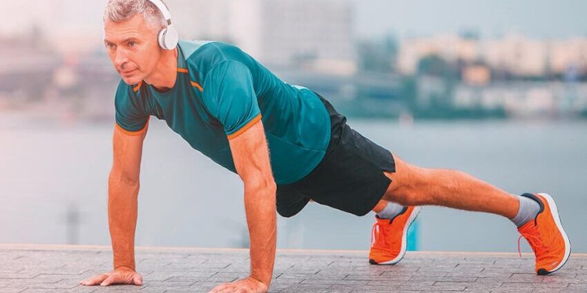 Man doing push-ups with headphones