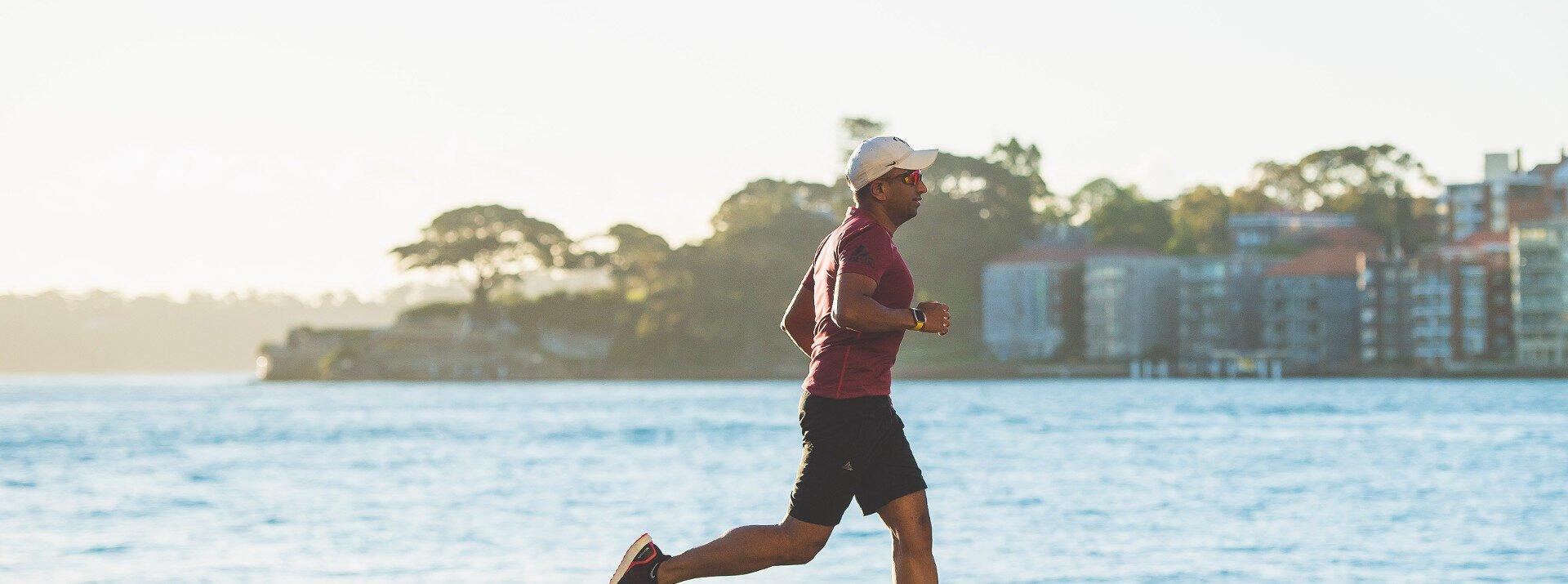 Man running near body of water